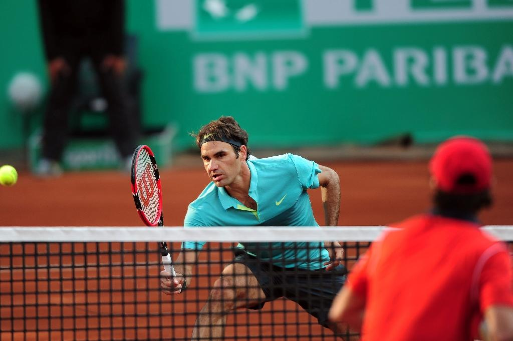 Federer ends clay drought with 85th title