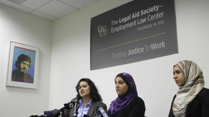 Hani Khan, center, a former stockroom worker for Abercrombie & Fitch Co. who was fired for refusing to remove her Muslim head scarf, sits with attorney Araceli Martinez-Olguin, left, of the Legal Aid Society and Zahra Billoo, right, executive director of the Council on American-Islamc Relations, during a news conference in San Francisco, Monday, June 27, 2011.  Khan is suing the clothing retailer in federal court, saying she was illegally fired after refusing to remove her hijab. (AP Photo/Eric Risberg)