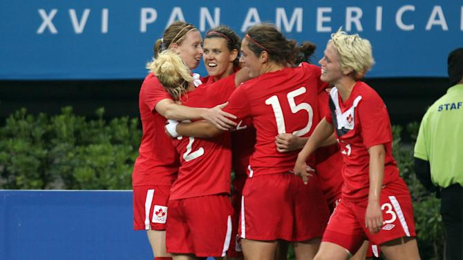 Canada's players celebrates after scoring during a women's soccer gold medal match against Brazil at the Pan American Games in Guadalajara, Mexico, Thursday, Oct. 27, 2011. (AP Photo/Juan Karita)