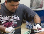 Master tattooist Su'a Paul Sulu'ape uses a traditional method to tattoo Ricky Masoe during an exhibition at the Wellington City Gallery in Wellington. Once banned by Christian missionaries as a barbaric, heathen custom, traditional tattooing is making a comeback in the Cook Islands as locals in the Pacific nation reconnect with their cultural roots