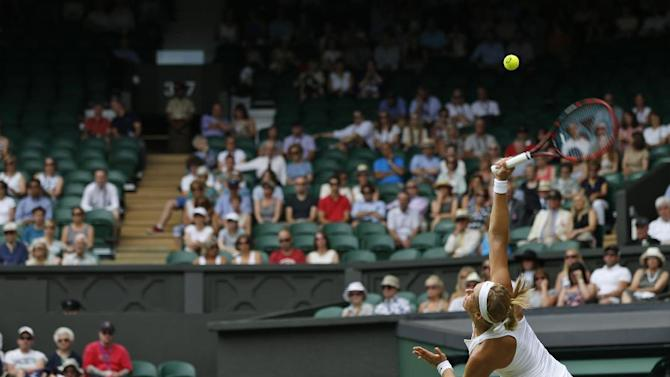 Sabine Lisicki of Germany serves to Christina Mchale of the United States, during their singles match at the All England Lawn Tennis Championships in Wimbledon, London, Thursday July 2, 2015. (AP Photo/Pavel Golovkin)