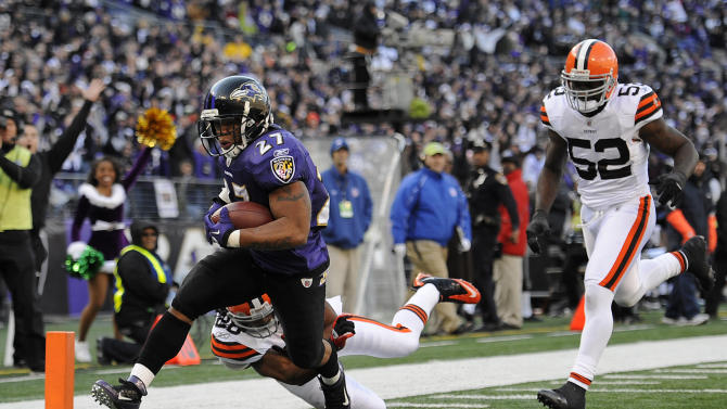 Baltimore Ravens running back Ray Rice (27) runs into the end zone for a touchdown past Cleveland Browns defenders Usama Young, back left, and D'Qwell Jackson (52) in the first half of an NFL football game in Baltimore, Saturday, Dec. 24, 2011. (AP Photo/Nick Wass)