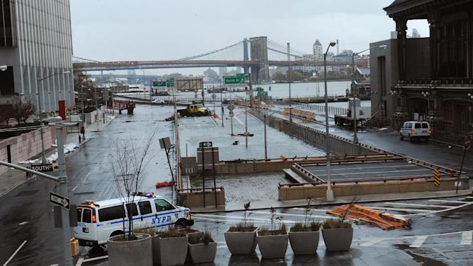 Water reaches the street level of the flooded Brooklyn Battery Tunnel, Tuesday, Oct. 30, 2012, in New York. Sandy arrived along the East Coast and morphed into a huge and problematic system, putting more than 7.5 million homes and businesses in the dark and causing a number of deaths. (AP Photo/Louis Lanzano)