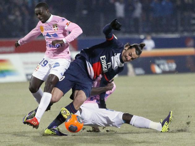 Ibrahimovic of Paris St-Germain challenges Sabaly of Evian Thonon Gaillard during their French Ligue 1 match in Annecy