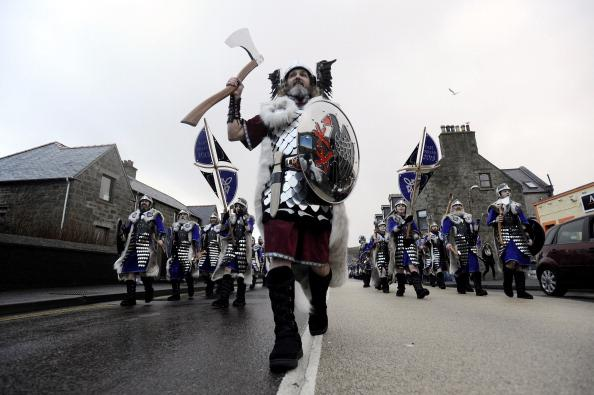 Participants dressed as Vikings march past during the annual Up Helly Aa festival in Lerwick, Shetland Islands on January 29, 2013. Up Helly Aa celebrates the influence of the Scandinavian Vikings in