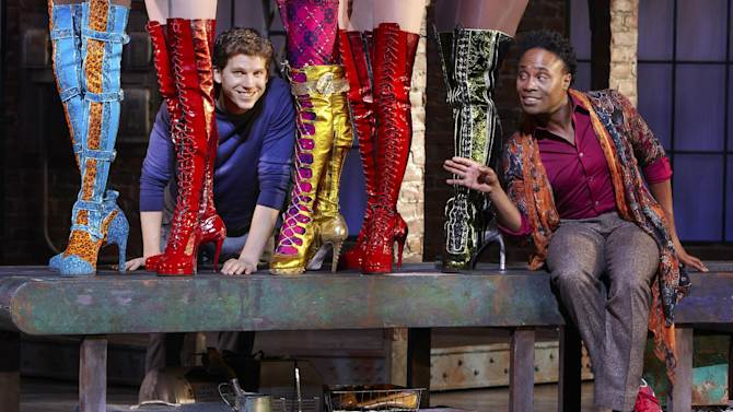 "In this Oct. 11, 2012 photo provided by Broadway in Chicago, actors Stark Sands, left, and Billy Porter are seen in a preview performance of ""Kinky Boots"" at the Bank of America Theatre in Chicago. Illinois has a tax credit to attract pre-Broadway and long-run shows to the state. ""Kinky Boots"" has applied for the tax credit. (AP Photo/Courtesy of Broadway in Chicago, Sean Williams)"