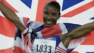 Denise Lewis drapes herself in the Union Flag after winning heptathlon gold at the Sydney Olympics in 2000