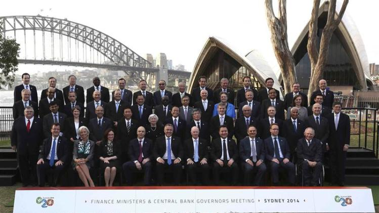 Central Bank Governors and Finance Ministers of G20 countries pose for a family picture near the Sydney Opera House and Sydney Harbour Bridge