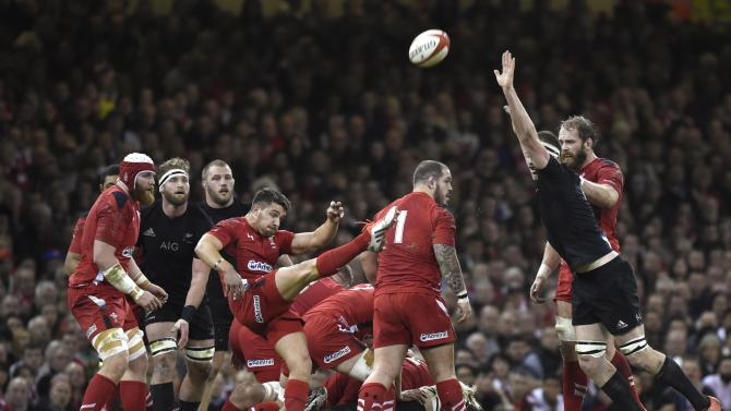 Wales' Webb clears the ball during their Autumn International rugby union match against New Zealand in Cardiff