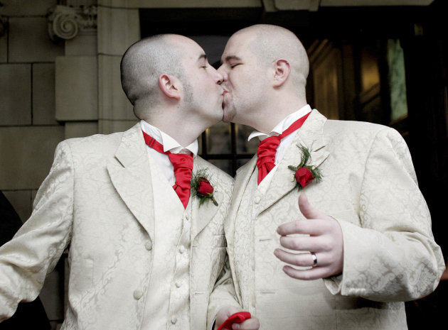 FILE- In this Monday, Dec. 19, 2005 file photo, Henry Edmont Cane, left,  and partner Christopher Patrick Flanaghan  kiss outisde Belfast, City Hall, Belfast, Northern Ireland, Monday, Dec. 19, 2005.