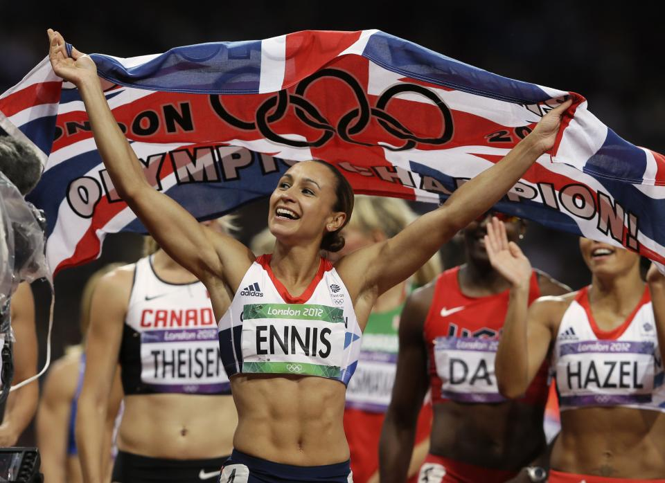 Britain's Jessica Ennis celebrates winning gold following the 800-meter heptathlon as she and other athletes complete a victory lap during the athletics in the Olympic Stadium at the 2012 Summer Olympics, London, Saturday, Aug. 4, 2012. (AP Photo/Kirsty Wigglesworth)
