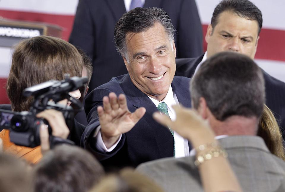 Republican presidential candidate, former Massachusetts Gov. Mitt Romney waves to supporters after speaking at a campaign stop in Charlotte, N.C., Wednesday, April 18, 2012. (AP Photo/Chuck Burton)
