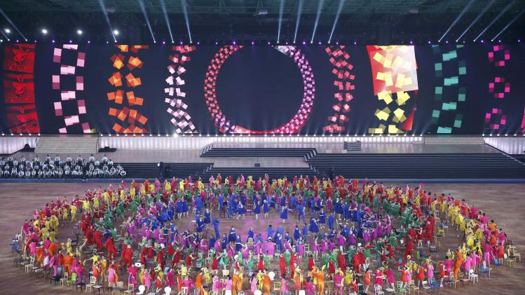 Dancers perform during the opening ceremony for the 2014 Commonwealth Games at Celtic Park in Glasgow, Scotland