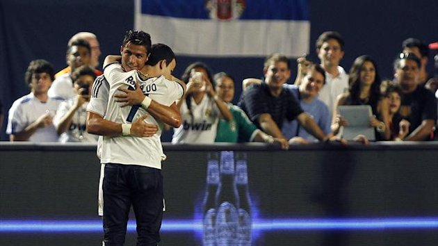 Real Madrid soccer star Cristiano Ronaldo was hugged by an over-enthusiastic fan (Reuters)