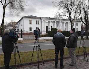 News cameramen wait outside the presidential residence …