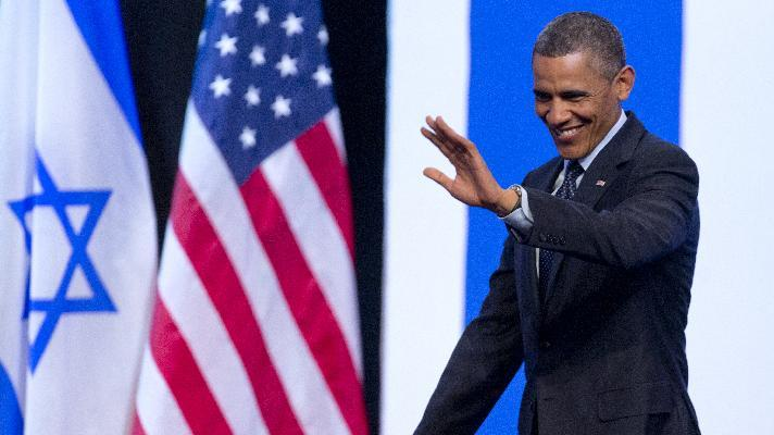 President Barack Obama waves to the audience as he arrives to speak at the International Convention Center in Jerusalem, Thursday, March 21, 2013. (AP Photo/Carolyn Kaster)
