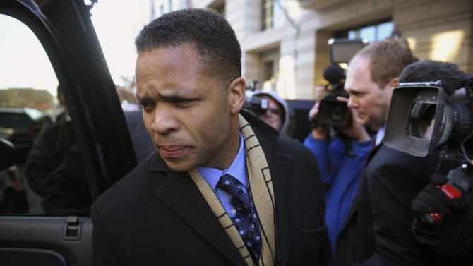 FILE - in this Feb. 20, 2013 file photo, former Illinois Rep. Jesse Jackson, Jr  leaves federal court in Washington after he entered a guilty plea to criminal charges that he engaged in a scheme to spend $750,000 in campaign funds on personal items. Residents in Illinois' 2nd District are preparing to vote in a special primary Feb. 26 to replace Jackson in the Chicago area district that has seen three congressmen leave office in an ethical cloud. (AP Photo/Cliff Owen, File)