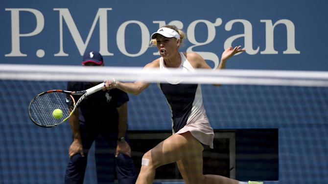 Caroline Wozniacki of Denmark returns shot against Jamie Loeb of U.S. during their match at the U.S. Open Championships tennis tournament in New York