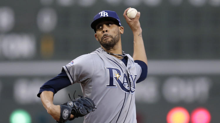 Tampa Bay Rays starting pitcher David Price winds up in the first inning against the Boston Red Sox during Game 2 of baseball's American League division series, Saturday, Oct. 5, 2013, in Boston. (AP Photo/Charles Krupa)