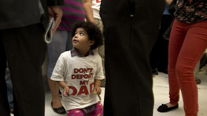 """Jackelin Alfaro, 4, in a t-shirt that reads """"Don't Deport my Dad"""" sits in the hall with family members outside the House Judiciary Committee hearing on Capitol Hill in Washington, Tuesday, June 18, 2013. The committee hearing will discuss the Strengthen and Fortify Enforcement Act. The committee in the Republican-led House is preparing to cast its first votes on immigration this year, on a tough enforcement-focused measure that Democrats and immigrant groups are protesting loudly. (AP Photo/Carolyn Kaster)"""