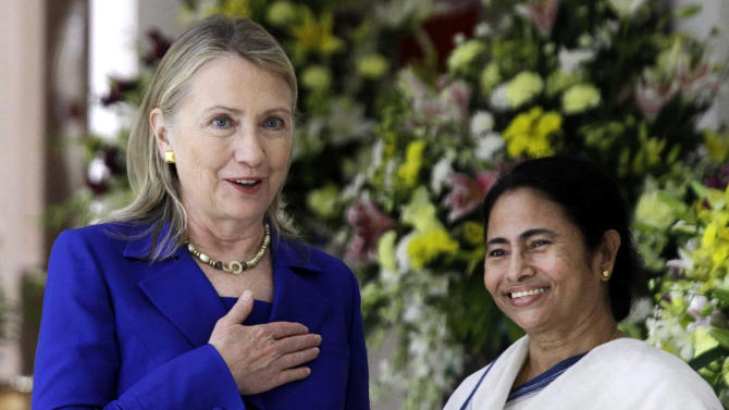 U.S. Secretary of State Hillary Rodham Clinton, left, gestures beside West Bengal Chief Minister Mamata Banerjee before a meeting in Kolkata, India, Monday, May 7, 2012. Clinton met with Mamata Banerjee, a key partner of India's ruling coalition who has stymied government efforts to lift restrictions on foreign-owned investments in the country. (AP Photo/Bikas Das)