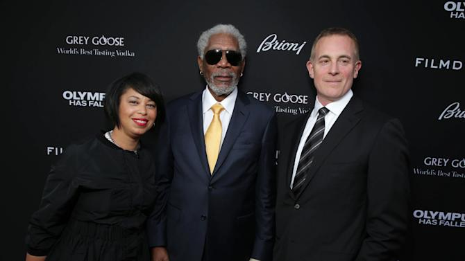 FilmDistrict's Christine Birch, Morgan Freeman and Executive Producer/FilmDistrict's Peter Schlessel at FilmDistrict's Premiere of 'Olympus Has Fallen' hosted by Brioni and Grey Goose at the ArcLight Hollywood, on Monday, March, 18, 2013 in Los Angeles. (Photo by Eric Charbonneau/Invision for FilmDistrict/AP Images)