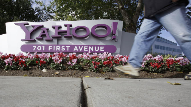 In this Dec. 1, 2010 file photo, a person walks by Yahoo! headquarters in Sunnyvale, Calif. Investors will be tuning into Yahoo Inc.'s first-quarter earnings call after the market close Tuesday to hear more details about CEO Scott Thompson's plans for turning around the beleaguered Internet company. (AP Photo/Paul Sakuma, file)