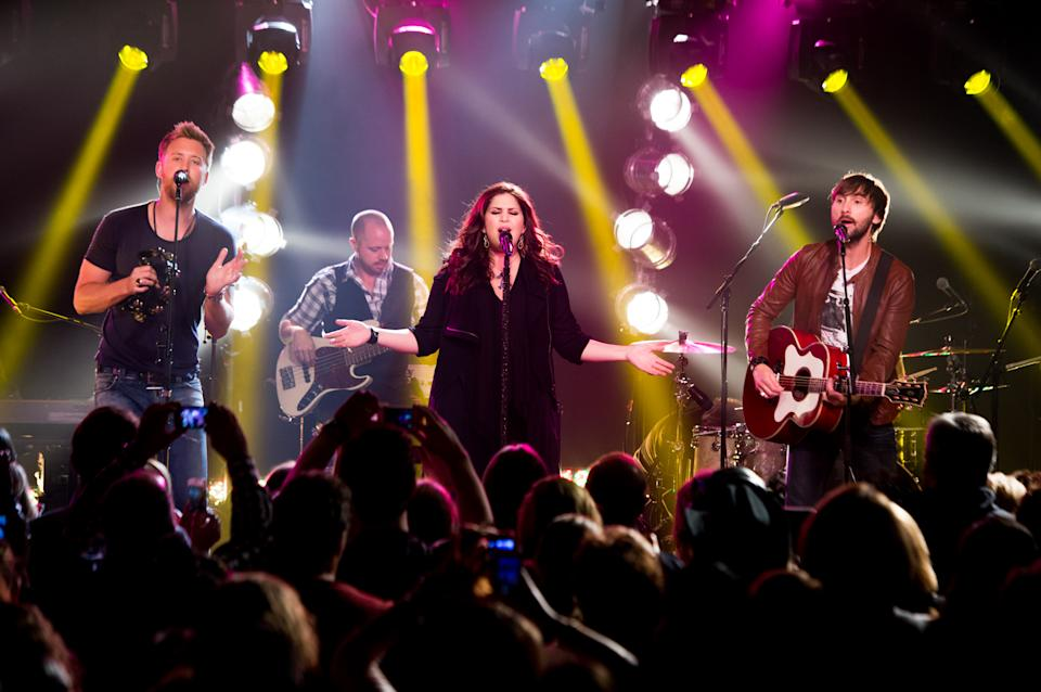 This May 8, 2013 photo released by iHeartRadio shows members of the band Lady Antebellum, from left, Charles Kelley, Hillary Scott, and  Dave Haywood during a performance in New York. The intimate show was part of iHeartRadio Live, a Clear Channel entertainment production that features performances by today's top recording artists. (AP Photo/iHeartRadio, Chris Owyoung)