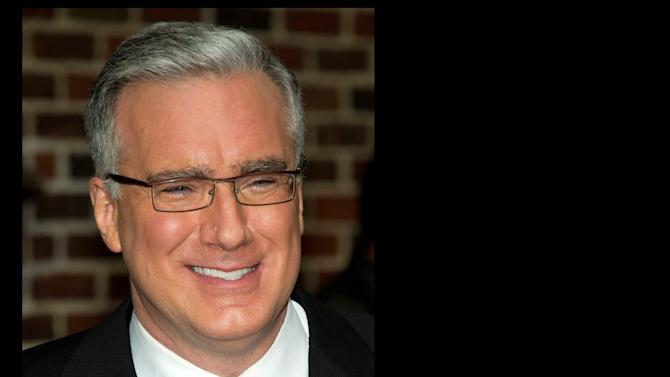"""FILE - In this Oct. 24, 2011 file photo, political pundit Keith Olbermann leaves a taping of the """"Late Show with David Letterman,"""" in New York. Olbermann sued his former bosses at Current TV in Los Angeles on Thursday, seeking more than $50 million for breach of contract and other claims. His case claims his show for the network was fraught with technical problems and he was fired without cause. (AP Photo/Charles Sykes, file)"""