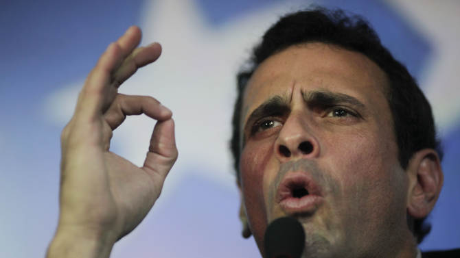 Opposition leader Henrique Capriles gestures during a press conference in Caracas, Venezuela, Sunday, March 10, 2013.  Capriles announced he will run in elections, scheduled for April 14, to replace late President Hugo Chavez, who died of cancer on March 5. (AP Photo/Rodrigo Abd)