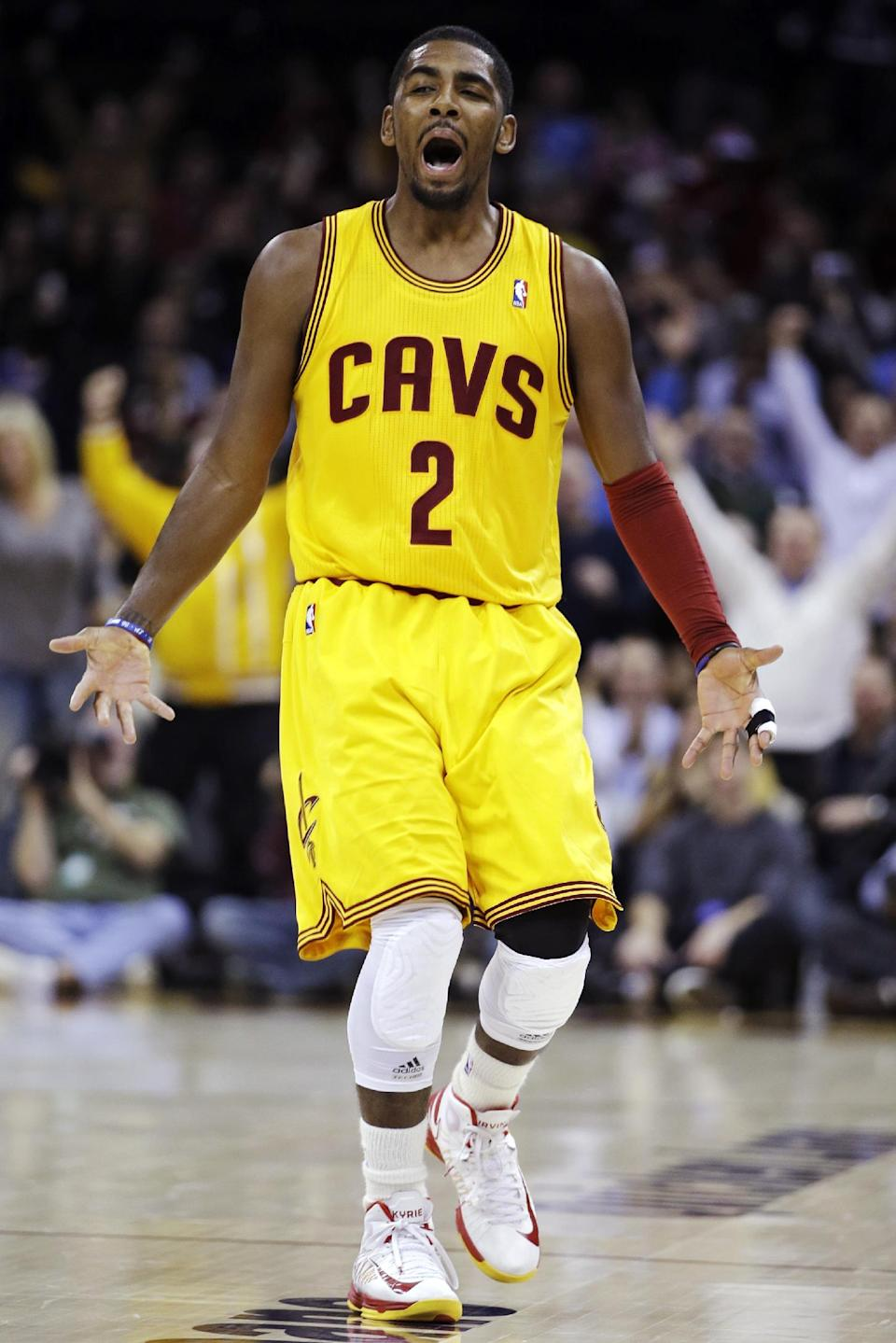 Cleveland Cavaliers' Kyrie Irving celebrates after making a 3-pointer against the Los Angeles Lakers in the second quarter of an NBA basketball game, Tuesday, Dec. 11, 2012, in Cleveland. (AP Photo/Mark Duncan)