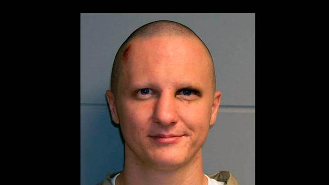 FILE - This photo released Tuesday, Feb. 22, 2011, by the U.S. Marshal's Service shows Jared Lee Loughner, the suspect in the Tucson shooting rampage that killed six people and left several others wounded, including then-U.S. Rep. Gabrielle Giffords. A person familiar with the Jared Lee Loughner case says a court-appointed psychiatrist will testify Tuesday, Aug. 7, 2012 that Loughner is competent to enter a plea in the murders and attempted murders including the wounding of former U.S. Rep. Gabrielle Giffords.  (AP Photo/U.S. Marshal's Office, File)