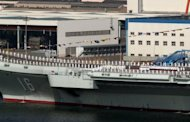 <p>China's first aircraft carrier, the Liaoning, is berthed at the northeastern port of Dalian in September. The Liaoning went into service in September in a symbolic milestone for China's growing military muscle.</p>