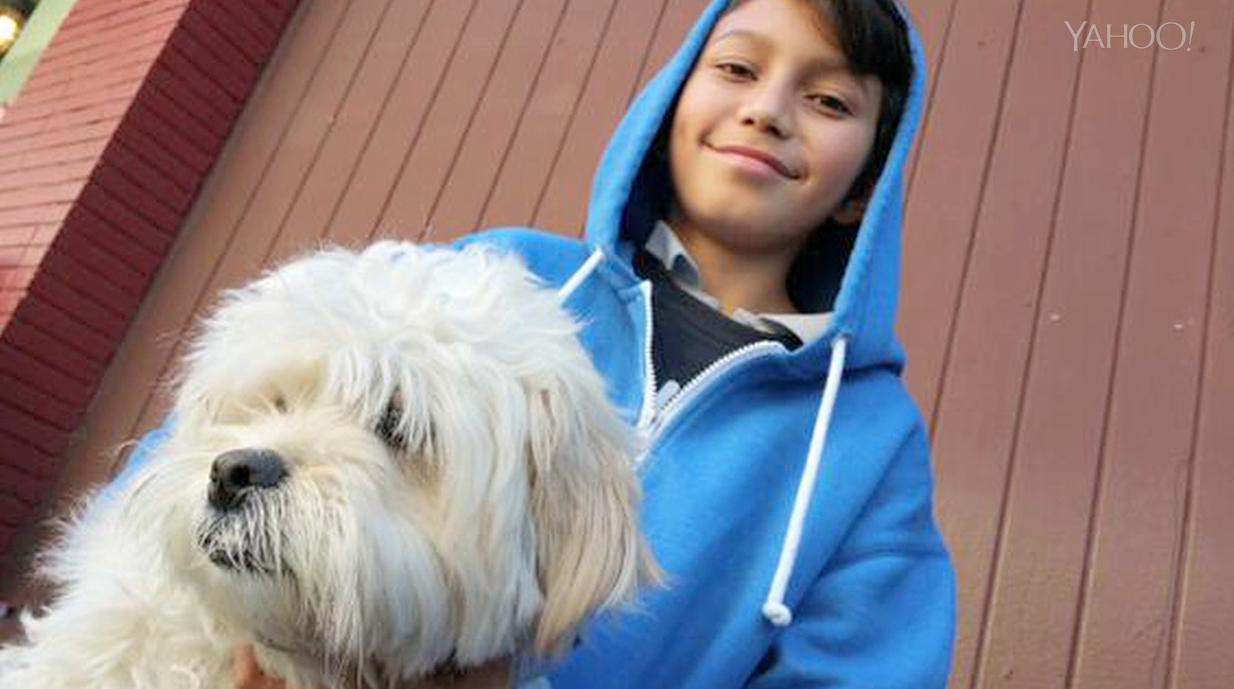 Boy jumps from burning building, saving his dog and himself