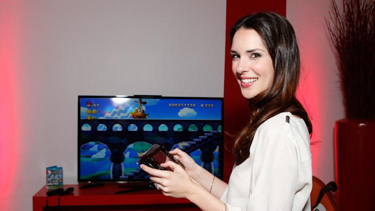 IMAGE DISTRIBUTED FOR NINTENDO- Actress Katie Savoy warms up and checks out Wii U at the Nintendo Lounge while playing Super Mario Bros. U during a break from the Sundance Film Festival on Friday, January 18, 2013 in Park City, UT. (Photo by Todd Williamson/Invision for Nintendo/AP Images)