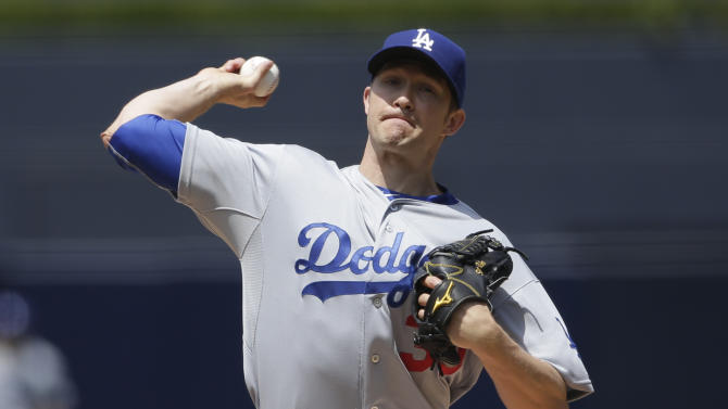 Los Angeles Dodgers starting pitcher Scott Baker pitches to a San Diego Padres batter during the first inning of a baseball game Sunday, April 26, 2015, in San Diego. (AP Photo/Gregory Bull)