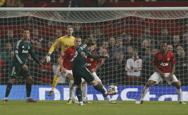 Real Madrid's Luka Modric scores against Manchester United during their Champions League soccer match at Old Trafford stadium in Manchester