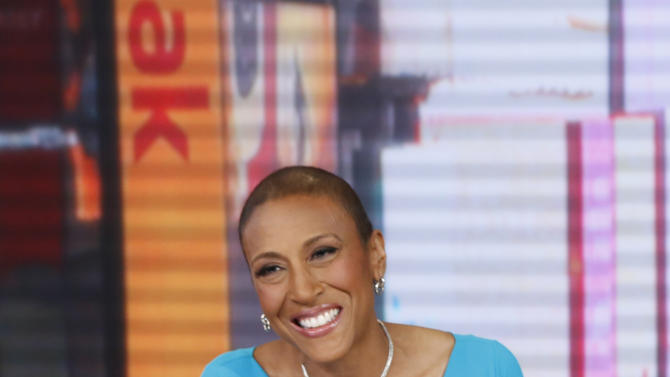 "This image released by ABC shows anchor Robin Roberts during a broadcast of ""Good Morning America,"" Wednesday, Feb. 20, 2013 in New York.  Roberts returned to the popular morning program after undergoing a bone marrow transplant five months ago.  (AP Photo/ABC, Heidi Gutman)"