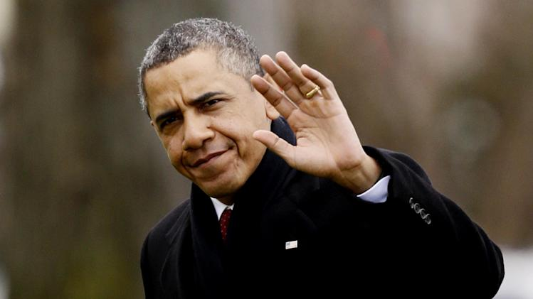 President Barack Obama waves to reporters as he steps off the Marine One helicopter and walks on the South Lawn at the White House in Washington, Thursday, Dec. 27, 2012, as he returns early from his Hawaii vacation for meetings on the fiscal cliff. (AP Photo/Charles Dharapak)