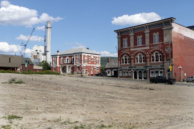 In this photo taken Thursday, Aug. 9, 2012, a vacant lot is seen on Main Street in Berlin, N.H.  As the city tries to get out of its deep depression since the closing of the paper mill, there are sign