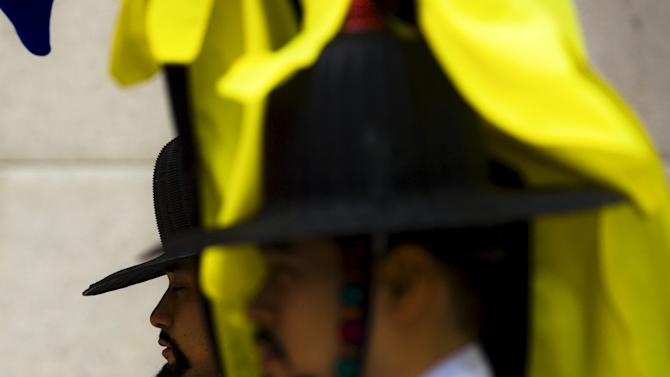 Palace guards take part in change of guards ceremony at gate to Gyeongbokgung Palace in Seoul