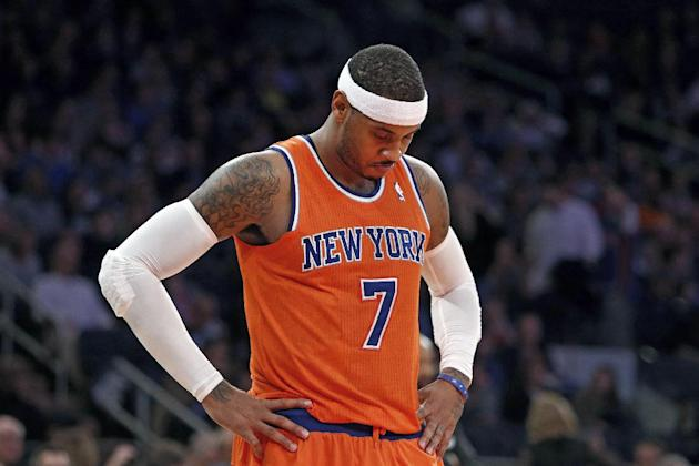 New York Knicks' Carmelo Anthony (7) waits during a break late in the second half action of an NBA basketball game against the Atlanta Hawks Saturday, Nov. 16, 2013, in New York.  Atlanta defeated New