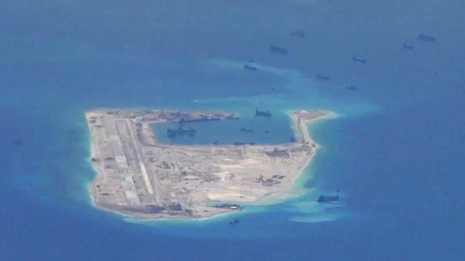 Still file image from a United States Navy video purportedly shows Chinese dredging vessels in the waters around Fiery Cross Reef in the disputed Spratly Islands
