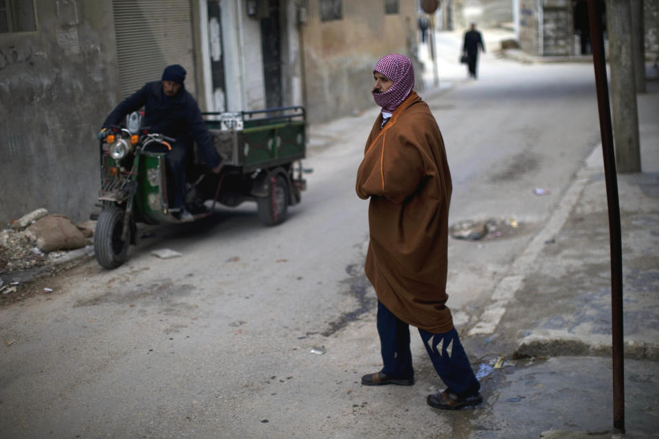 A man walks in downtown Idlib, north Syria, Saturday, March 3, 2012. (AP Photo/Rodrigo Abd)