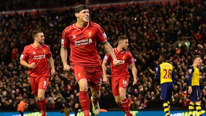 Liverpool's Martin Skrtel (2nd L) celebrates scoring his team's second goal during their English Premier League match against Arsenal at Anfield, on December 21, 2014