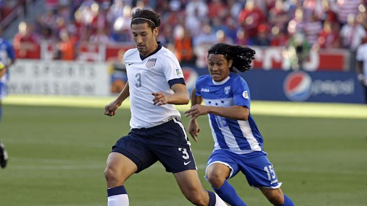Honduras' Roger Espinoza (15) defends as United States' Omar Gonzalez (3) clears the ball in the first half during a World Cup qualifying soccer match at Rio Tinto Stadium on Tuesday, June 18, 2013, in Sandy, Utah.  (AP Photo/Rick Bowmer)