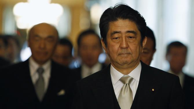 Abe walks to attend an opening ceremony of the ordinary session of parliament in Tokyo