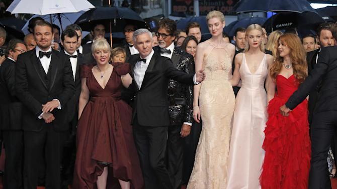 From left, actors Leonardo DiCaprio, production designer Catherine Martin, director Baz Luhrmann, actors Amitabh Bachchan, Elizabeth Debicki, Carey Mulligan and Isla Fischer walk the red carpet for the opening ceremony and the screening of The Great Gatsby at the 66th international film festival, in Cannes, southern France, Wednesday, May 15, 2013. (AP Photo/Francois Mori)