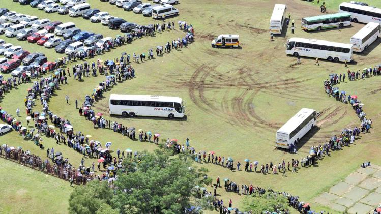 GCIS handout shows aerial view of people queuing to view the body of former South African President Mandela as he lies in state at the Union Buildings in Pretoria