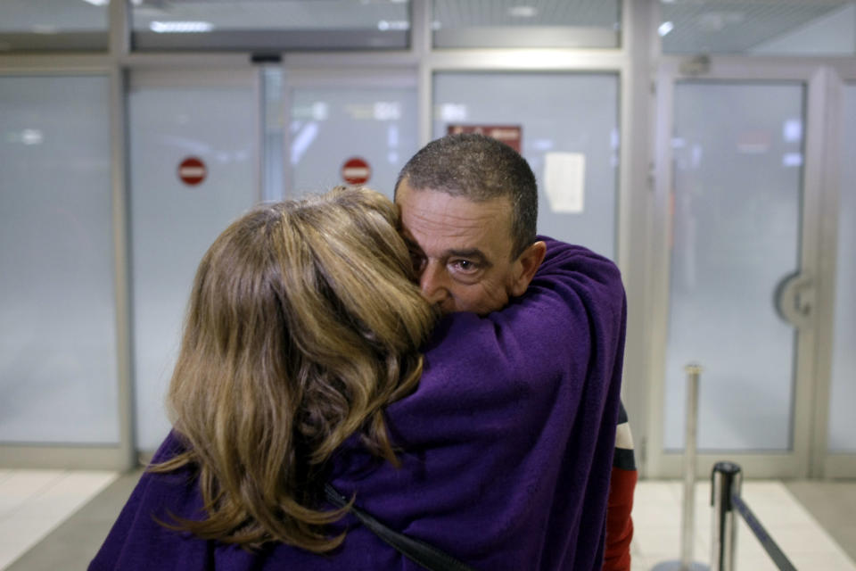 A Serbian man is greeted by his wife as he arrives from Tripoli, Libya to Belgrade, Serbia, Wednesday, Feb. 23, 2011. The Serbian government sent three planes to Libya on Wednesday to evacuate Serbian citizens who wanted to leave the country due to the current uprising. (AP Photo/ Marko Drobnjakovic)